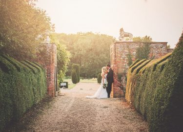 bride and groom on Hales Hall driveway