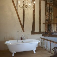 roll top bath in bridal suite with chandelier in gatehouse