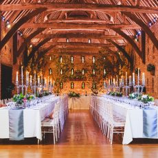 table set up in thatched barn at hales hall Norwich