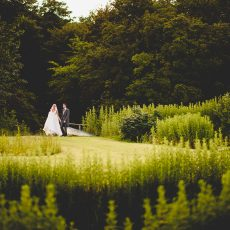 bride and groom in grounds of hales hall gardens Norwich