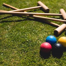 Croquet on the lawn at grade I thatched barn at Hales Hall norfolk