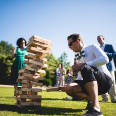 wedding guests playing jenga at hales hall after wedding ceremony in norfolk