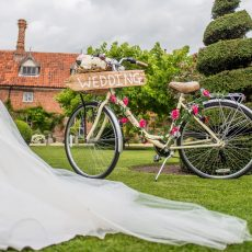 bride's wedding dress on lawn at hales hall norfolk