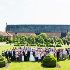 family photo at wedding on lawn at hales hall great barn norfolk