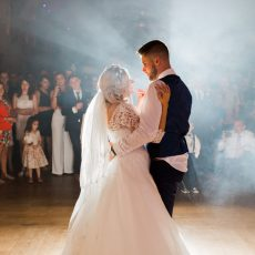 Bride and Groom enjoying their first dance at the evening wedding reception at Hales Hall & The Great Barn Norfolk Loddon