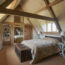 bedroom in hales hall recently refurbished from an attic in norfolk