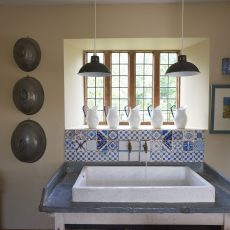 sink in country kitchen at hales hall norfolk