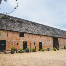 tudor thatched barn at hales hall norfolk wedding venue
