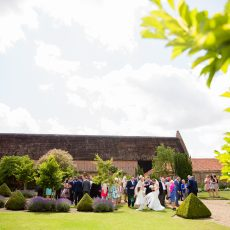 grade I thatched Tudor barn at hales hall in norfolk wedding venue