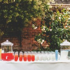 drinks reception after wedding ceremony in the thatched tudor brick barn at hales hall norfolk