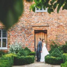 bride and groom on their wedding day after getting married at Hales Hall & The Great Barn in Loddon norfolk