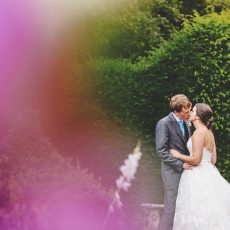 bride and groom enjoying the gardens on the morning of their wedding in norfolk