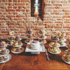 selection of wedding cakes at wedding reception at the oldest thatched tudor brick barn in Britain