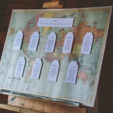 world map table plan at hales hall and the great barn wedding reception
