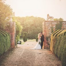 bride and groom in driveway at hales hall great barn norfolk