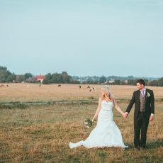 bride and groom on hales hall common after getting married at Hales Hall and the Great Barn
