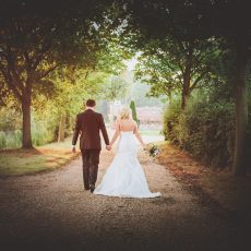 bride and groom walking onto hales common Loddon after wedding day