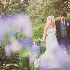bride and groom enjoying the hales hall grounds on their wedding day