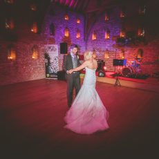 bride and groom dancing at their evening wedding reception at hales hall great barn Loddon norfolk Suffolk