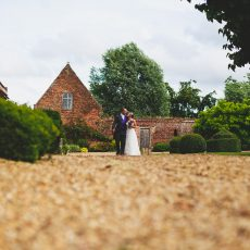 bride and groom at hales hall country estate on the morning of their wedding in Norfolk