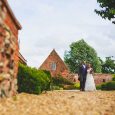 bride and groom at hales hall on the morning of their wedding Norwich