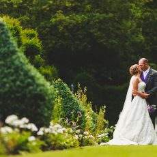 photo by James Rouse photography of bride and groom in gardens oh Hales Hall Norfolk / Suffolk