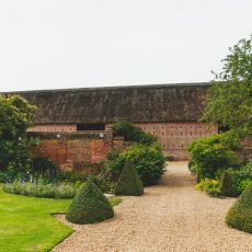 views of the grade I listed thatched barn in Loddon norfolk from Hales Hall House