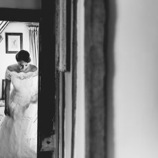 bride getting ready in the hales hall accommodation before her wedding ceremony in the Great Barn at Hales Hall