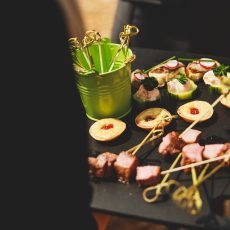 canapes being served at a wedding reception at hales hall and the great barn norfolk