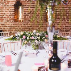 flowers on top table at wedding reception photo by James Rouse photography