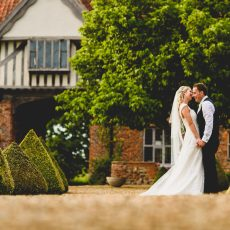 photo taken by James rouse photography bride and groom in grounds of hales hall