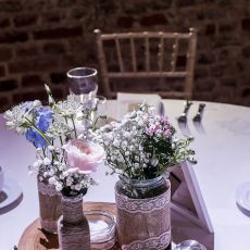flowers on table at wedding reception at hales hall norfolk