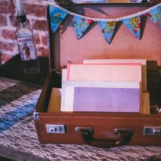 suitcase as wedding decorations at Liann & Tom's wedding, photo by James Powell Photography Hales Hall Great Barn Norfolk