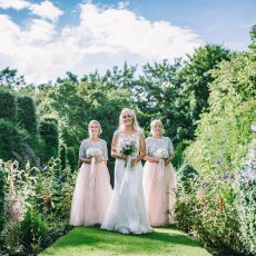bride and bridesmaids in long landscaped gardens at hales hall & the great barn Loddon