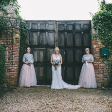 james powell photography bride and bridesmaid at hales hall barn norfolk Norwich