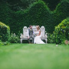 bride and groom enjoying the gardens at Hales Hall norfolk in Loddon