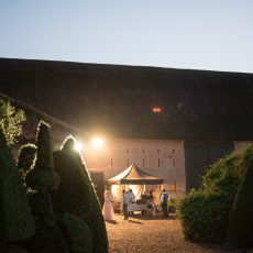 thatched barn evening wedding reception at hales hall