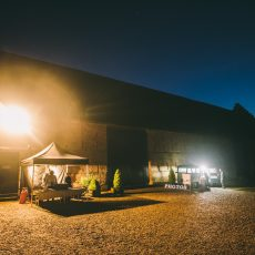 Evening wedding reception outside the oldest surviving tudor brick barn in Britain