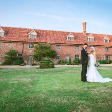 bride and groom infront of Hales Hall in Loddon on Norfolk Suffolk border