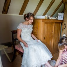 bride getting ready the morning of her wedding at hales hall Loddon norfolk