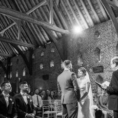 bride and groom at their wedding ceremony at hales hall. marry in norfolk registrar