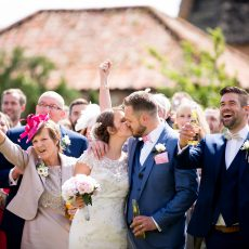 bride and groom after getting married at Hales Hall Barn norfolk. Photography by Kathy Ashdown