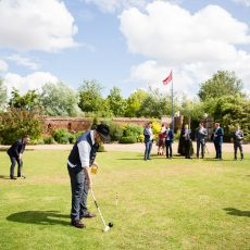 wedding guests playing lawn games at hales hall wedding venue in Norwich norfolk