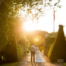 Bride and Groom at sunset at Hales Hall & the Great Barn Loddon Norfolk Photography by Kathy Ashdown