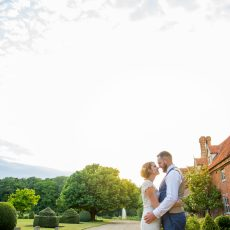 bride and groom infront of Hales Hall in Norfolk on their wedding day