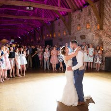 bride and groom having their first dance at Hales Hall & The Great Barn Norfolk at their wedding reception