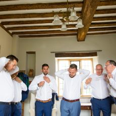 Groom and his Groomsman getting ready in the Gatehouse at Hales Hall before his Wedding ceremony in the Thatched Tudor Brick Barn norfolk